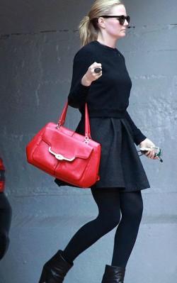 Jennifer Morrisonn street style, red handbag with black skirt, boots and polar neck