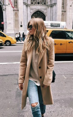 How to style a casual camel coat outfit - blue jeans and sunglasses, sweater and camel coat