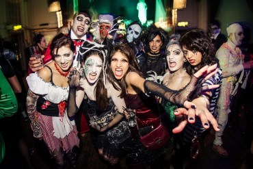 adults enjoying a halloween party