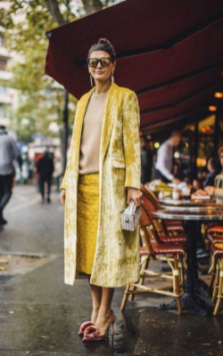Woman in yellow pencil skirt and coat, fashion week street style - 50 best pencil skirt