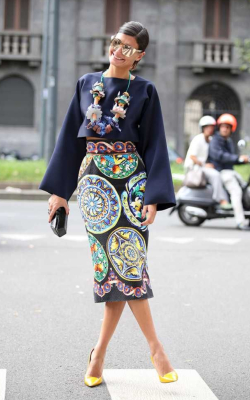 Fashion week street style woman in black pencil skirt with graphic design and a black blouse