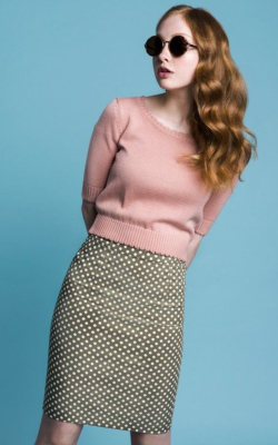 Model in pink top and polka dot pencil skirt