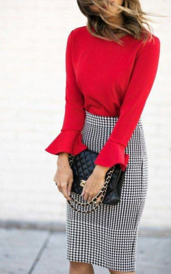 Model in red sweater and checked pencil skirt