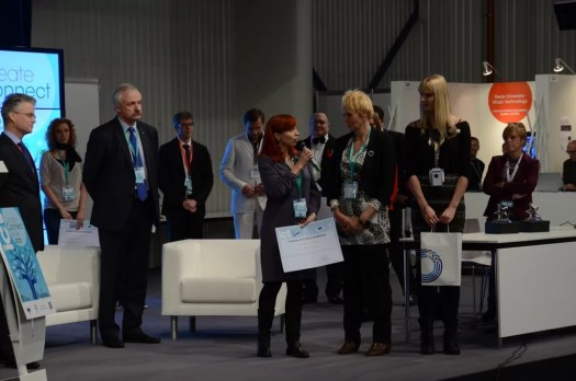 ICT & Art Connect stand receiving Best Booth Award at ICT2013