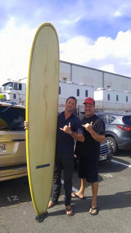 Alex O'Loughlin with brawner board surfboard