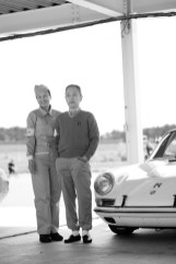 Tetsu Ikuzawa and his wife pose with the team Porsche