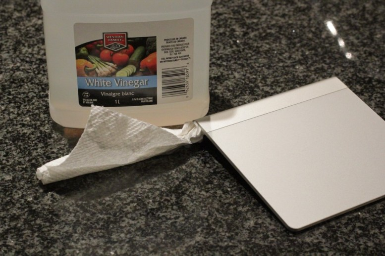 Vinegar damped paper towel inserted into the battery compartment of the Apple Trackpad