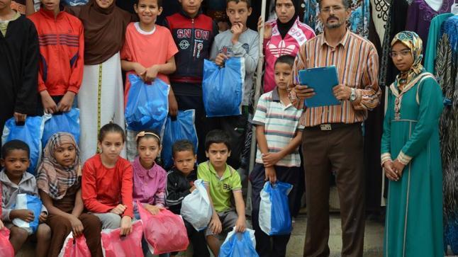 ادخال السعادة على اكثر من 150 يتيم بواسطة كسوة العيد