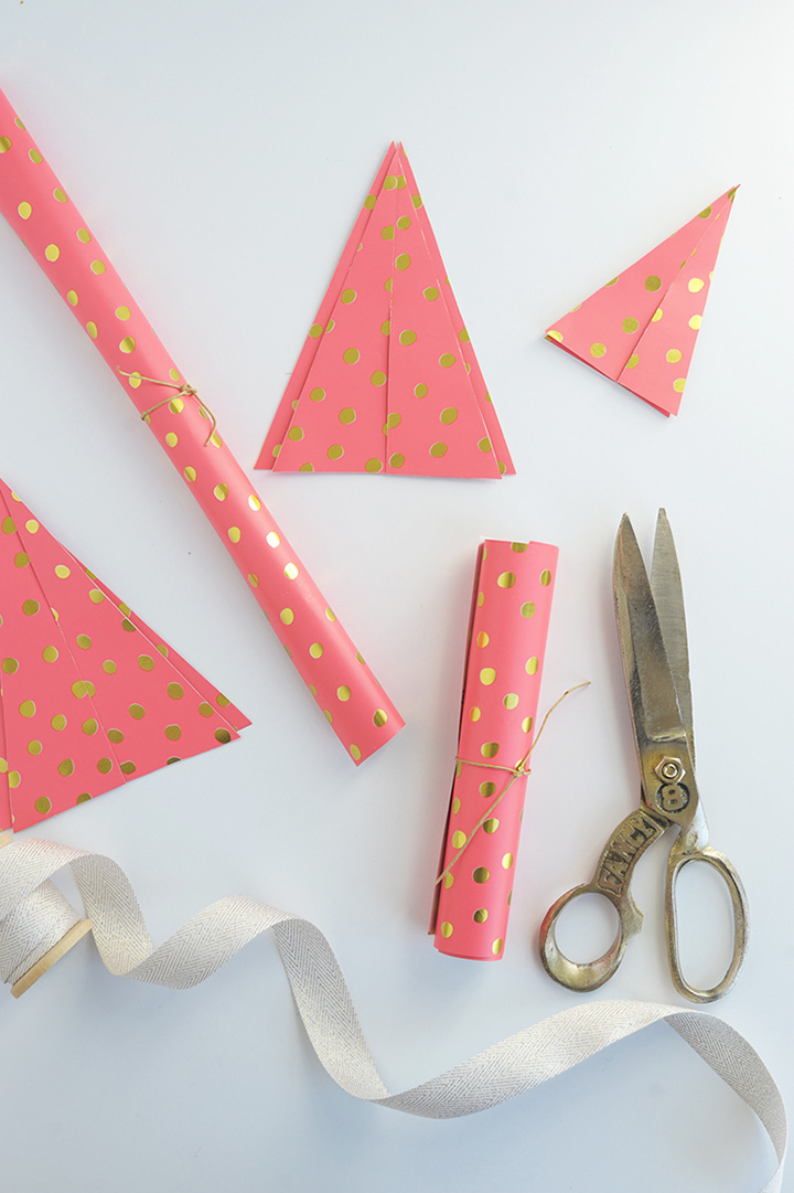 Make these sweet paper Christmas trees out of wrapping paper!