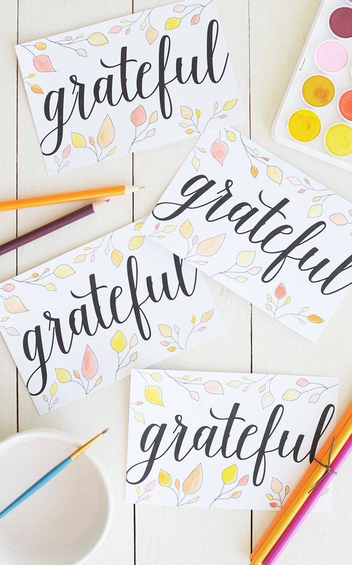 "Send your friends and family a note around Thanksgiving letting them know how thankful you are to have them in your life with these free printable ""Grateful"" postcards."