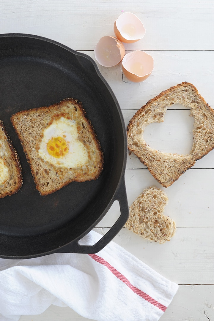 Such a simple, healthy breakfast to celebrate Valentine\'s Day. Heart-shaped eggs and toast along with watermelon pops!