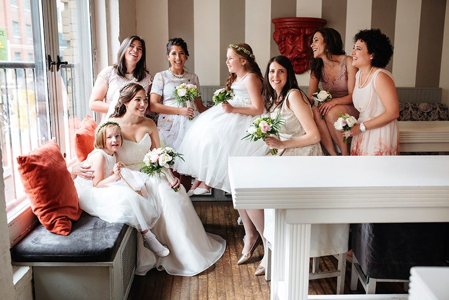 Wedding party sitting by a window
