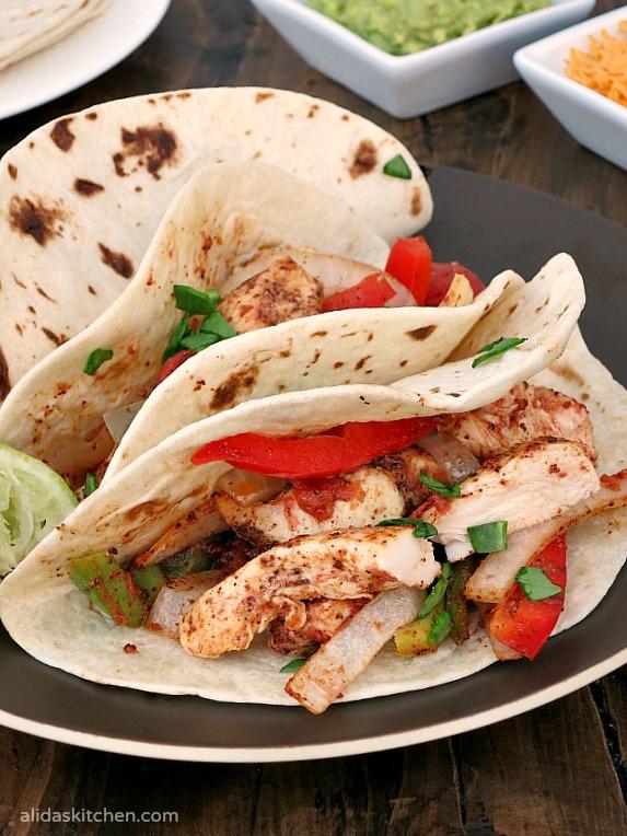 An easy recipe for Baked Chicken Fajitas | alidaskitchen.com