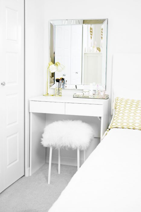 DIY faux fur stool styled underneath IKEA dressing table in girl's bedroom