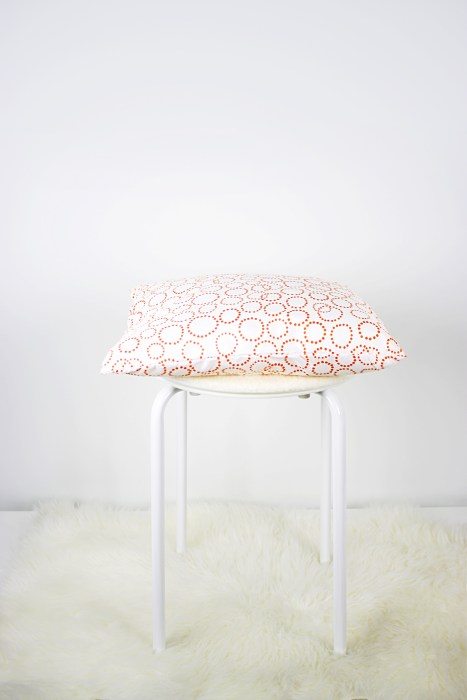 Pillow and chair pad pictured on top of stool