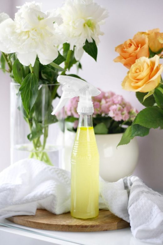 Spray bottle filled with natural DIY rose petal-infused cleanser