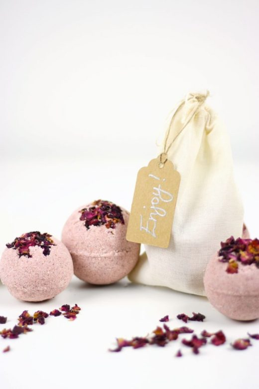 DIY all-natural rose petal bath bombs pictured with cotton gift bag