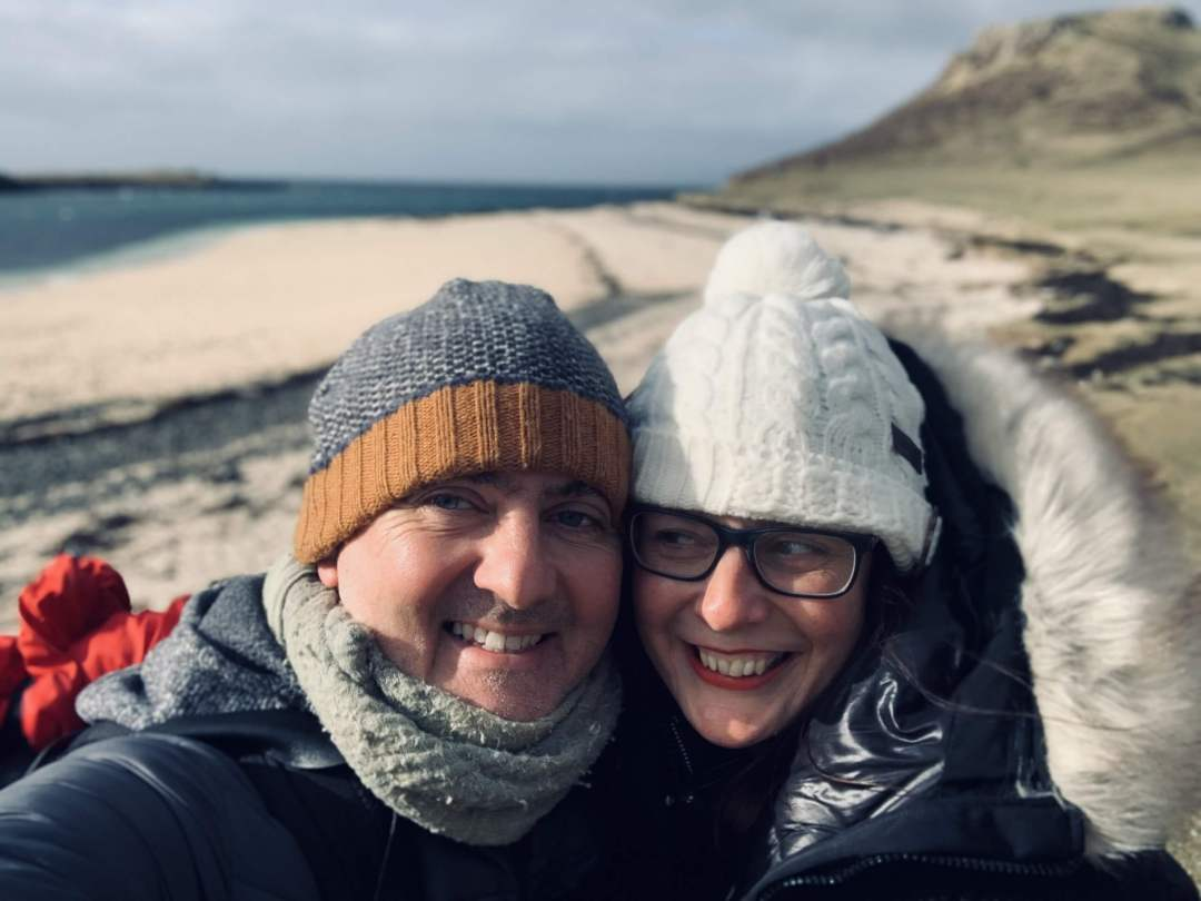 Jo and Alex on a beach in Skye