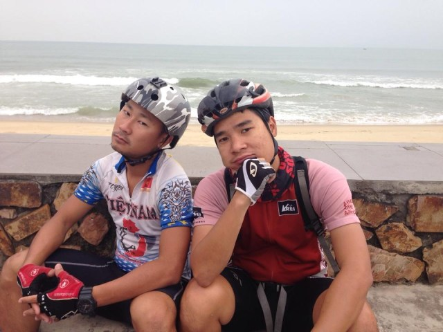 Thai (left) and Vu (right), striking a pose as we take a break from biking in Vietnam.