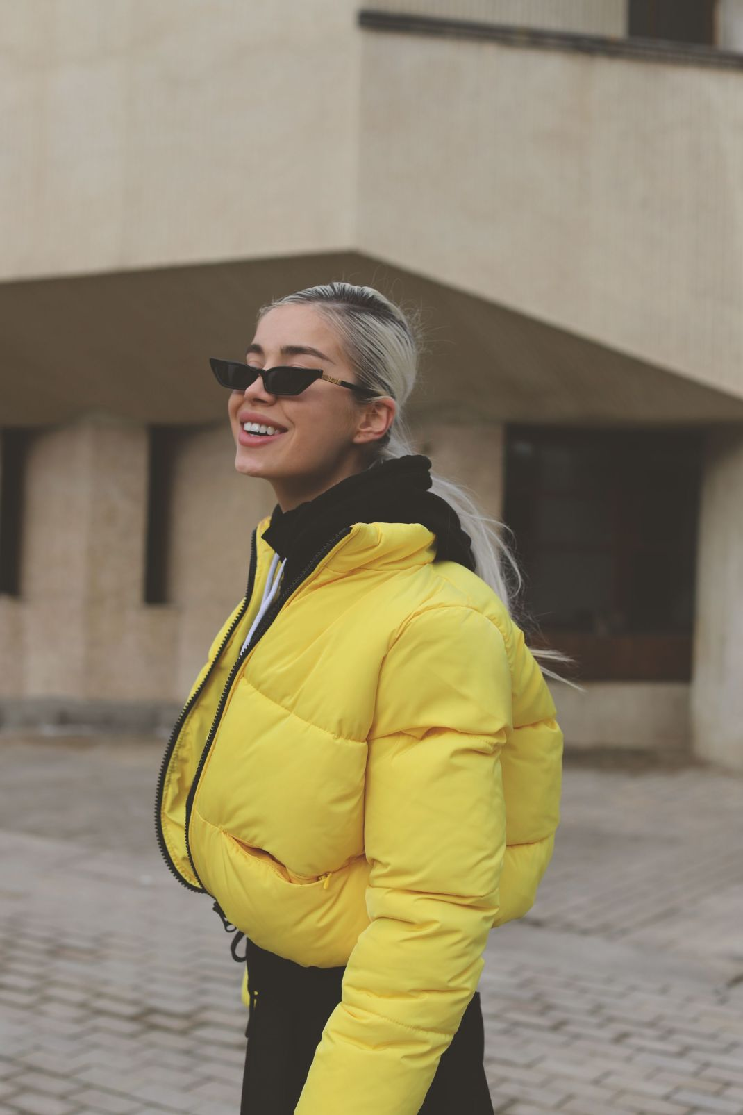 That yellow puffed jacket
