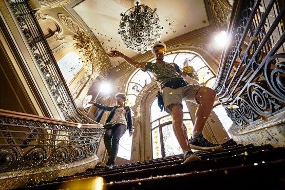 Marketa and her assistant spreading gold glitter over the big staircase