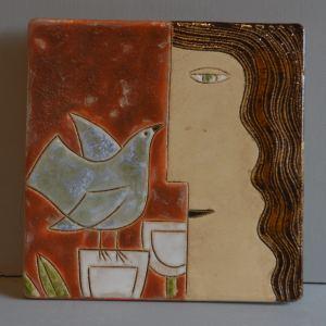 Face & bird wall plaque
