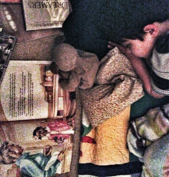 Little boy reading Ruby Bridges book