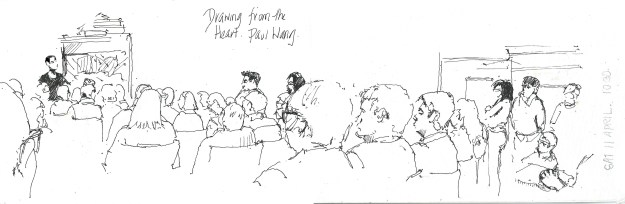 Sketching the  urban Sketchers listening and watching Paul speak