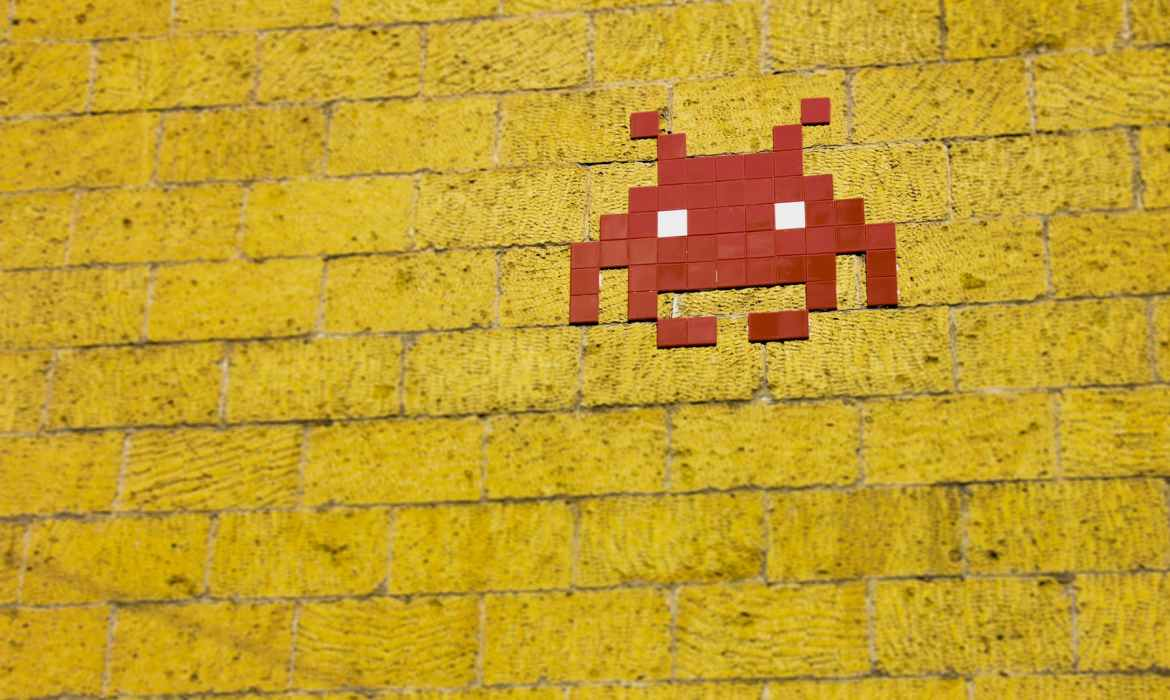 retro game icon painted on wall
