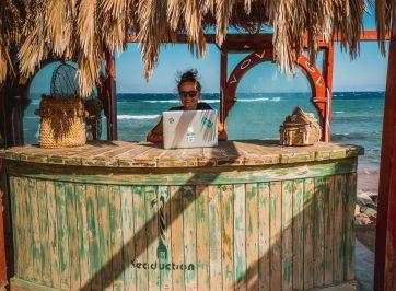 digital nomad working at beach