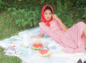 woman at picnic in cottagecore aesthetic