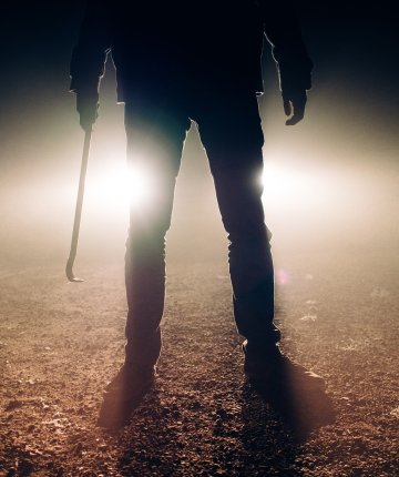 man in headlights, holding crow bar