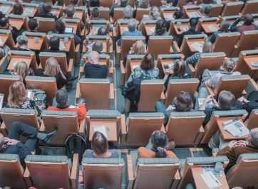 students sitting in large lecture hall