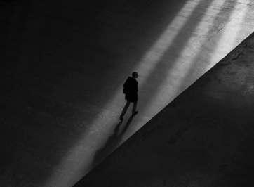 Man walking alone in the dark