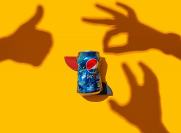 pepsi can on yellow background
