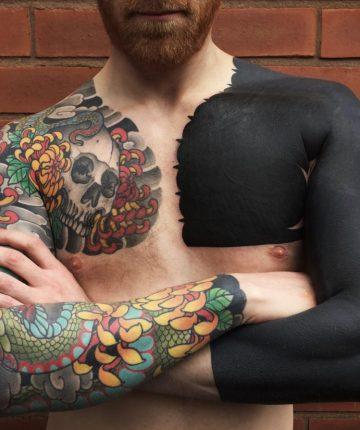 left arm and shoulder blackout tattoo
