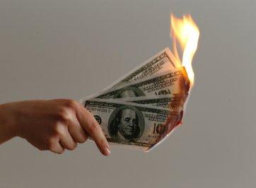 dollar bills on fire