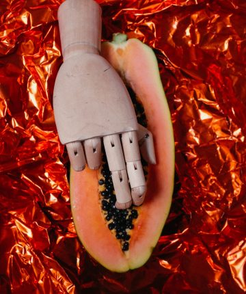 mannequin hand on sliced papaya