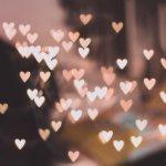 many tiny hearts on blurred background