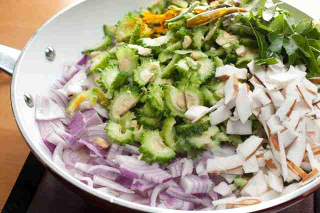 Bittergourd stir-fried with onion, thin coconut pieces, and spices. In Kerala, this dish is popular as Pavakka Mezhukkupuratti. This Bitter Gourd Fry is a quick and healthy side dish that goes along with rice.