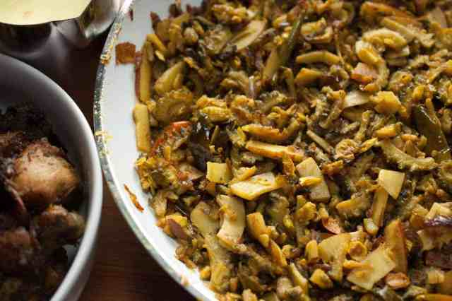 Bitter gourd stir-fried with onion, thin coconut pieces, and spices. In Kerala, this dish is popular as Pavakka Mezhukkupuratti. This Bitter Gourd Fry / Karela Fry is a quick and healthy side dish that goes along with rice.