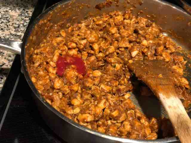 This is an image of tomato ketchup added to sauteed masala