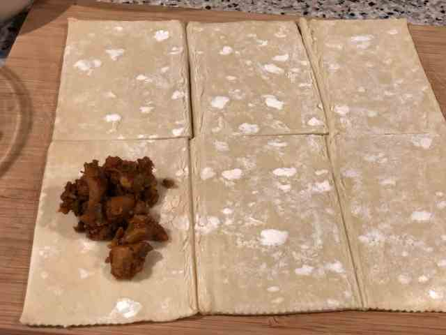 This is an image of puff pastry sheet cut into squares