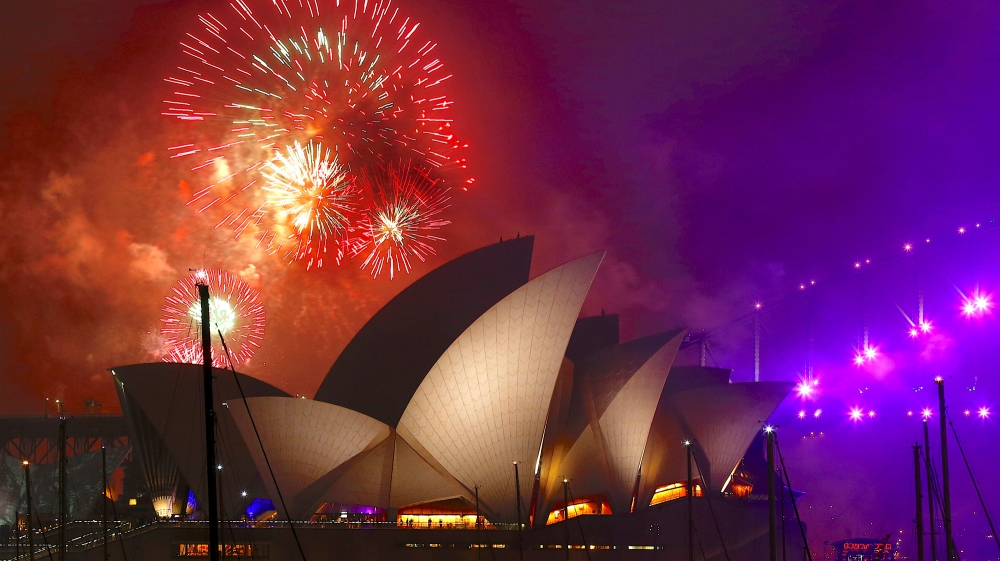 Happy New Year  Cities across the world welcome 2018   News   Al Jazeera Fireworks explode near the Sydney Opera House as part of new year  celebrations on Sydney Harbour  Australia   David Gray Reuters