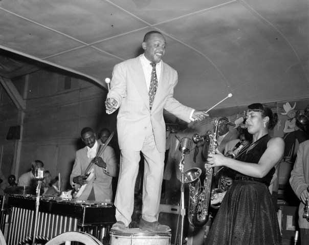 In this photo by Hickman, the renowned jazz musician Lionel Hampton leads his band performing in Dallas on 12 March 1953. Hickman's interest in photography developed during his World War II military service, leading to him becoming an official Army photographer. After the war''s end, he returned to Dallas and began a professional career as a photographer at the Dallas Star Post newspaper, before working for various other local papers and the National Association for the Advancement of Colored People (NAACP). [RC Hickman; RC Hickman Photographic Archive, Briscoe Center for American History]