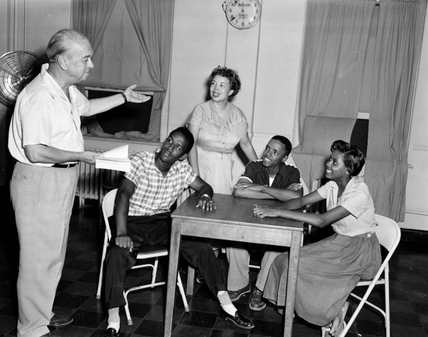 "Actors preparing for a play at the Little Theatre in Dallas on 10 August 1953. ""These are images of the ordinary lives of extraordinary people who succeeded in spite of all the obstacles in their path, and who eventually demanded and, in important ways, won their rights,"" Texas Senator and US Congresswoman Barbara Jordan said of Hickman's work. [RC Hickman; RC Hickman Photographic Archive, Briscoe Center for American History]"