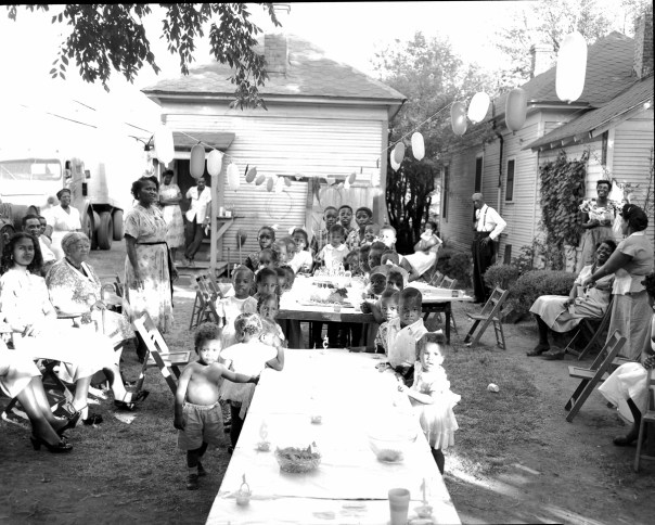 A children's birthday party in 1955 through the lens of Hickman, who as a freelance photographer for local papers also captured much uglier scenes when covering the civil rights struggle. In August 1956, when Hickman arrived in Manseld, Texas, to document the integration of the local high school, he saw figures swinging from the playground trees: effigies of black students, mock-lynched by a white mob. Hickman worked quickly to capture the scene but was spotted by the mob, who then tried to capture him, before he managed to escape by car. [RC Hickman; RC Hickman Photographic Archive, Briscoe Center for American History]