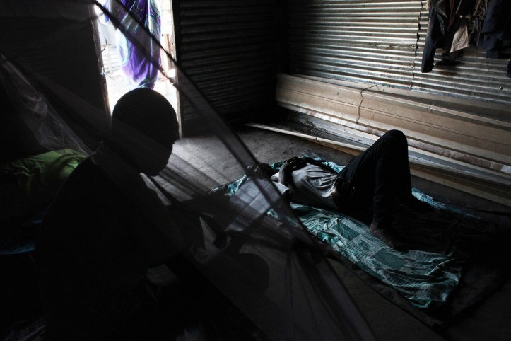 O, 16, from Leer, is reading in a makeshift home belonging to a family member in the Protection of Civilians site (POC) in Bentiu, where he has been living for the last two years. He was outside the POC to buy charcoal, when he was abducted by soldiers and taken away in a pick-up car. 'There were only women and older men with me then, so they only took me. They tied me up and told me I was going to fight for them.' Next to Bentiu town, he stayed with about 40 other young men. 'We were told we were going to fight the rebels. They said we'd have the guns, so that the people would give us money and that the cattle we could take would be ours.' After about 10 days, he escaped and made his way back to the POC. He says he does not dare to go out of the perimeter since he was abducted. [Andreea Campeanu/Al Jazeera]