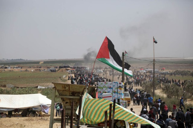"For the first weeks of the March, Palestinians set up protest camps near the border fence between Israel and the Gaza Strip. The tents were removed mid-May, after Nakba Day. Since then, every Friday, thousands of Palestinians walk to the ""no-go"" zones at different points along the fence. [Mohammed Zaanoun/Active Stills/Al Jazeera]"