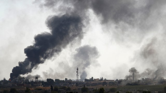 Smoke rises over the Syrian town of Tel Abyad, as seen from the Turkish border town of Akcakale
